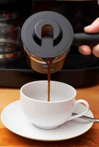 Photo of coffee being poured into cup